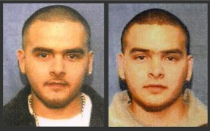 """FILE - This undated combination of file photos from wanted posters released by the U.S. Marshals Service shows Pedro Flores, left, and his twin brother, Margarito Flores. On Tuesday, Jan. 27, 2015, at federal court in Chicago, Chief U.S. District Judge Ruben Castillo sentenced the brothers to 14 years in prison each for running a nearly $2 billion North American drug ring, agreeing with prosecutors to drastically reduce their sentences as reward for their cooperation against Joaquin """"El Chapo"""" Guzman and other Mexican cartel leaders. (AP Photo/U.S. Marshals Service, File)"""